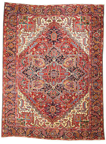 A Heriz carpet  Northwest Persia size approximately 9ft. 7in. x 13ft.