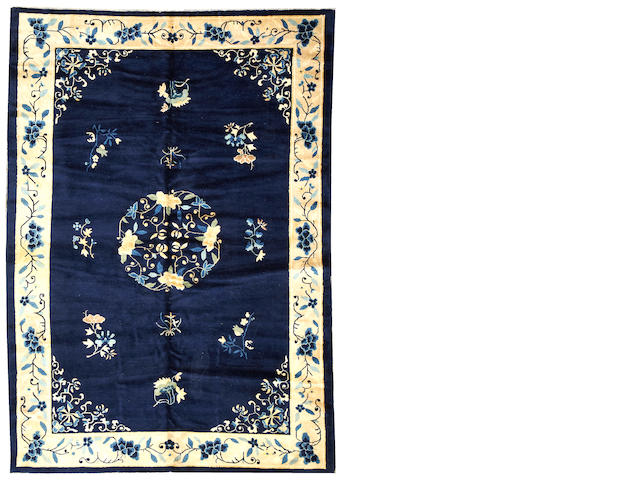A Peking carpet  China size approximately 6ft. x 9ft.