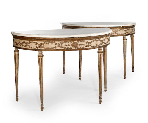A pair of Italian Neoclassical gilt paint decorated demilune console tables <BR />late 18th century with restorations
