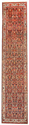 A Malayer runner Central Persia size approximately 3ft. 6in. x 16ft. 3in.
