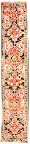 A Karabagh runner Caucasus size approximately 3ft. 8in. x 18ft. 5in.
