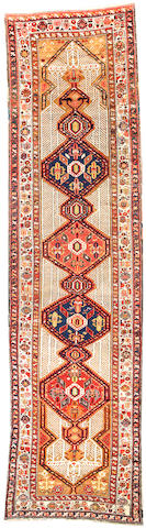 A Serab runner Northwest Persia size approximately 3ft. 6in. x 13ft. 6in.