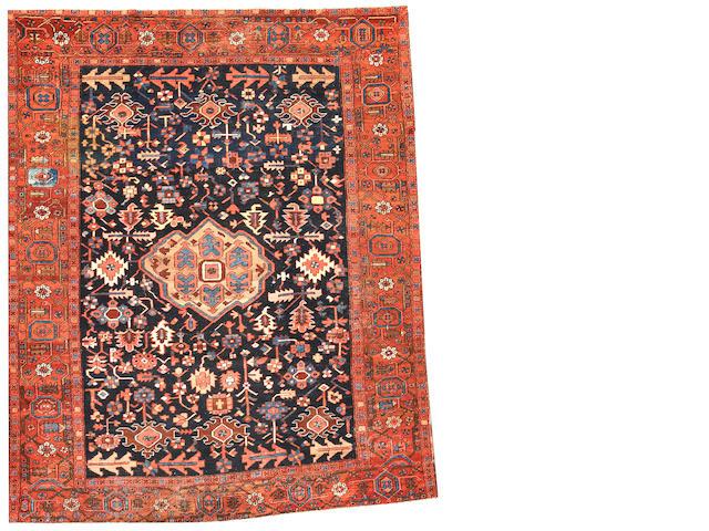 A Heriz carpet  Northwest Persia size approximately 10ft. x 12ft.