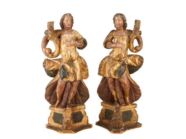 A pair of Continental Baroque parcel gilt paint decorated figures