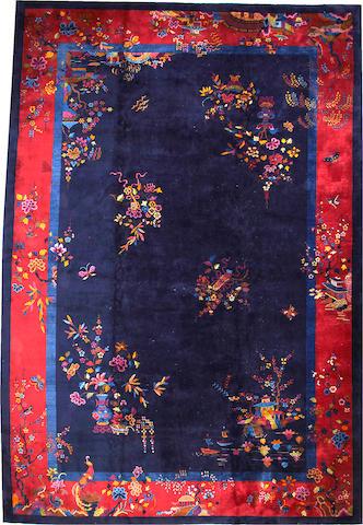 A Chinese Art Deco carpet China size approximately 12ft. 5in. x 19ft.