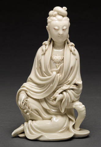 A Dehua porcelain figure of Guanyin (thumb restored) late Qing dynasty