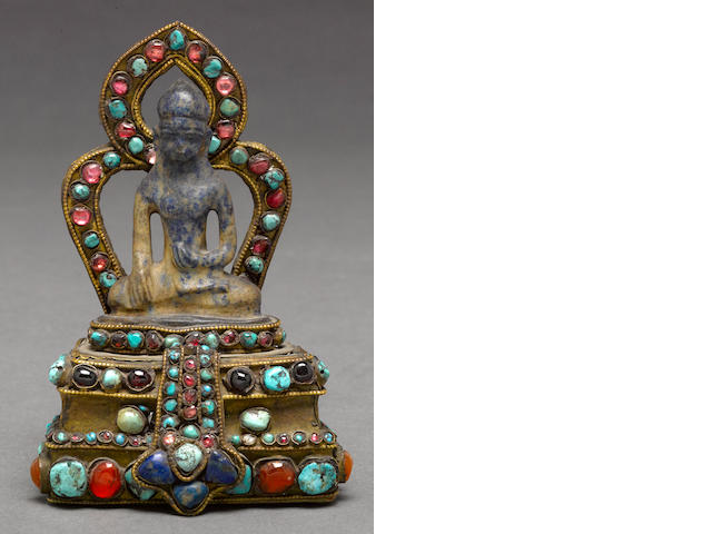 An inlaid copper aloy figure of a seated Buddha