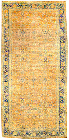 A Kerman long carpet South Central Persia size approximately 10ft. x 21ft.