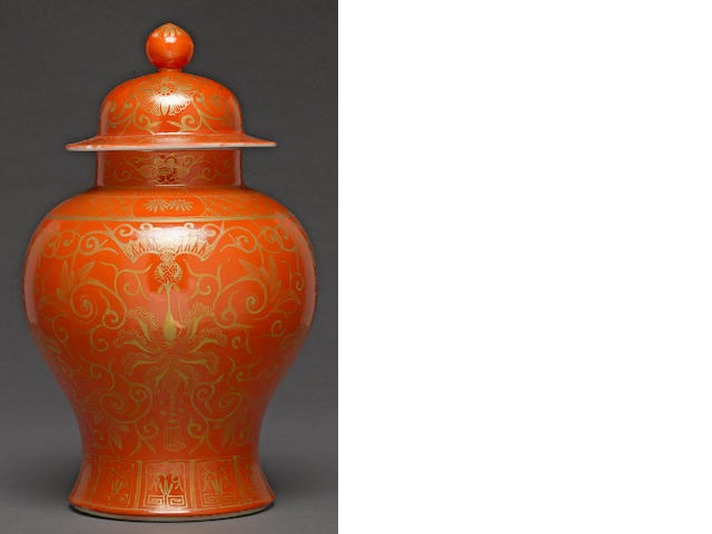 A coral ground and gilt enameled porcelain lidded jar late Qing/Republic period