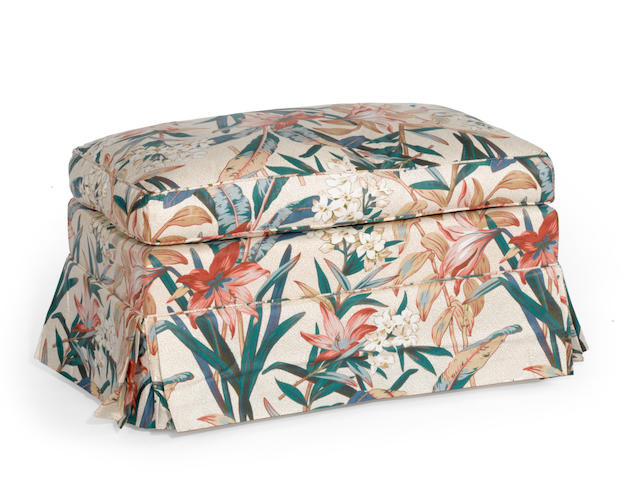 A contemporary floral upholstered ottoman