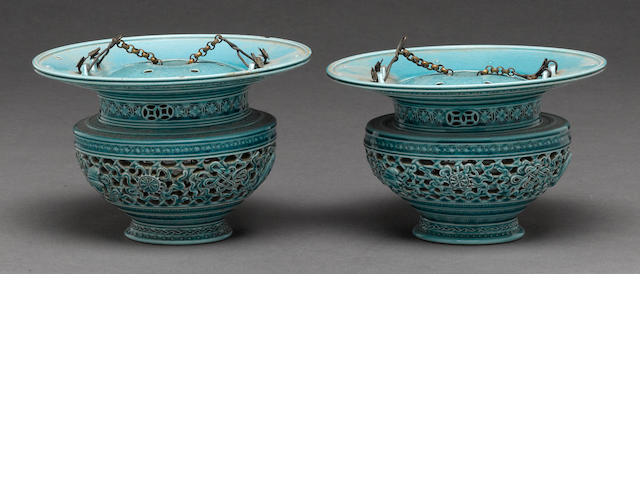 A pair of turquoise glazed soft paste porcelain reticulated hanging vases late Qing dynasty