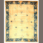 A Chinese carpet  China size approximately 8ft. 11in. x 11ft. 8in.