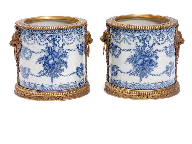 A pair of Neoclassical style gilt bronze mounted porcelain jardinières