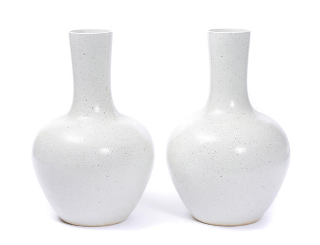 A pair of large Chinese white glazed vases