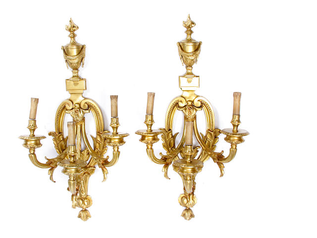 A pair of Louis XV style gilt bronze wall lights