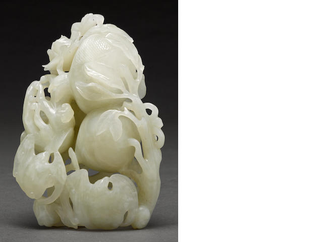 A carved white jade bats and fruit group Republic period