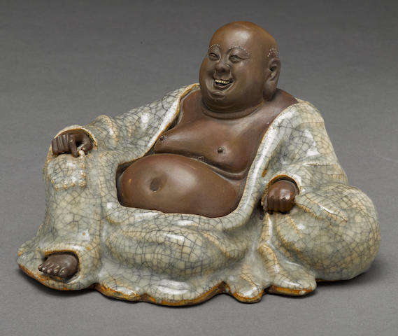 A Shiwan glazed ceramic figure of Putai late Qing dynasty