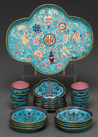 A collection of Canton enamel small cups and saucers, together with a lobed form dish late Qing dynasty