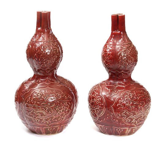 A pair of Chinese red glazed vases
