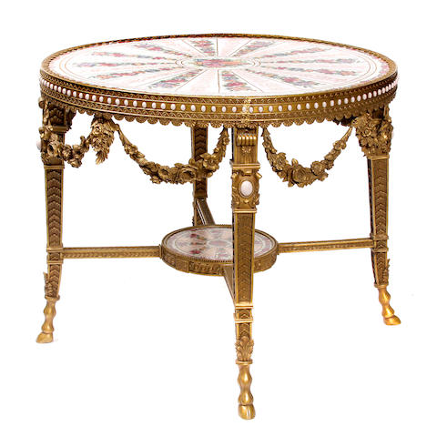 A Louis XVI style gilt bronze and porcelain center table