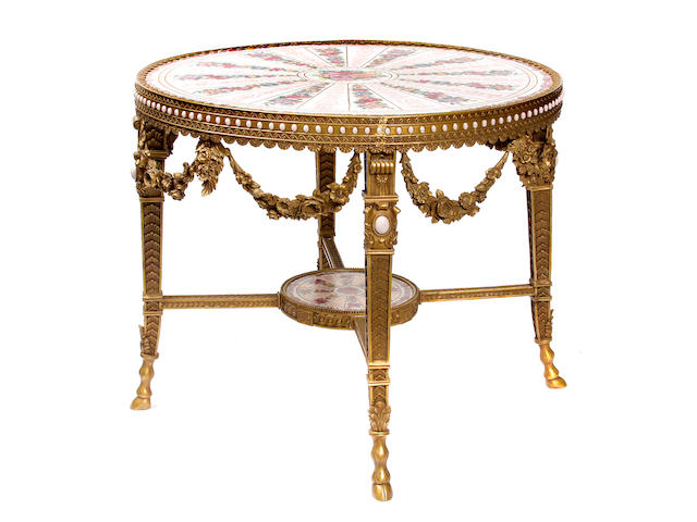 A Louis XVI style gilt bronze and porcelain mounted center table