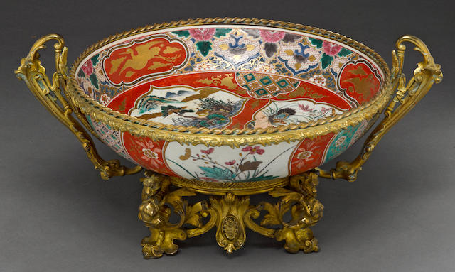 A large Kutani bowl with gilt metal mounting Meiji period