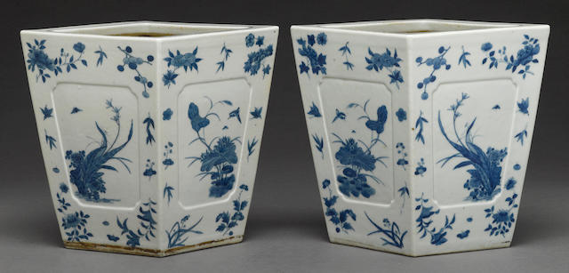 A pair of blue and white glazed porcelain jardinières
