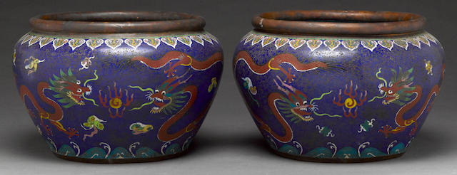 A pair of cloisonné enameled metal jardinières with dragon decoration Republic period