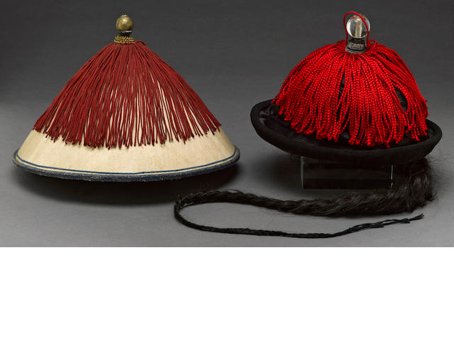 Two Manchu hats with case, one with queue, and finials