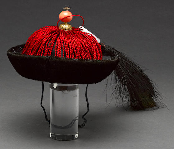 A Manchu hat with peacock feather and hardstone holder