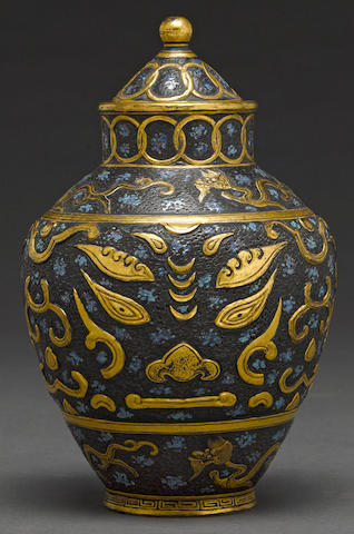 An iron and gilt decorated molded porcelain vase and cover late Qing/Republic period (chips to cover and footrim, losses)