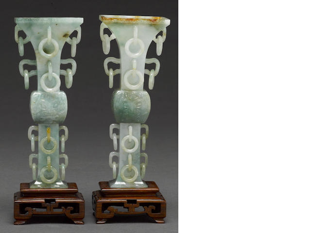 A pair of jadeite 'gu' form vases with loose rings