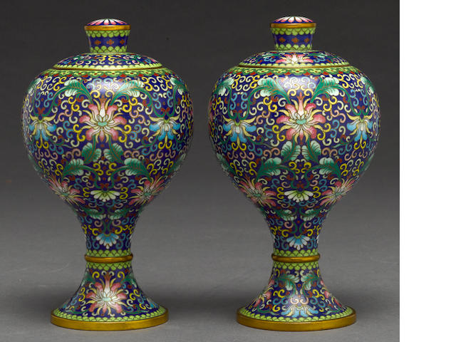 A pair of Chinese cloisonne covered urns circa 1970's