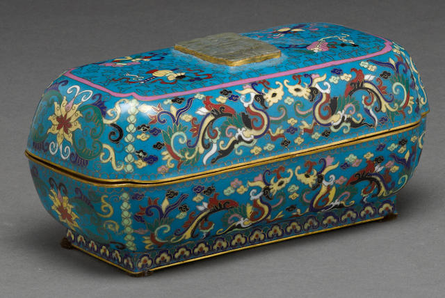 A cloisonné enameled metal box mounted with a jade plaque