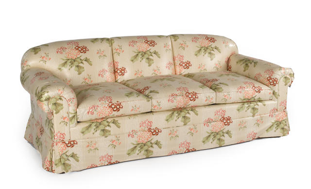 A contemporary triple cushion floral chintz upholstered sofa