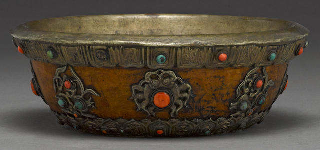 A Tibetan metal mounted bowl with inlaid coral and turquois beads