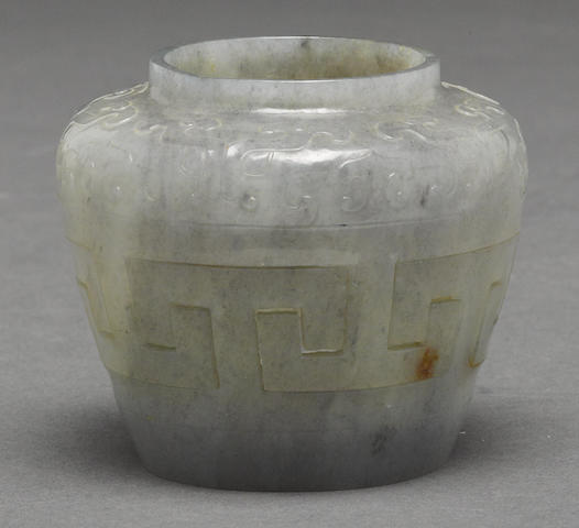 A grey jade jarlet with key fret open work and archaic motif decoraion