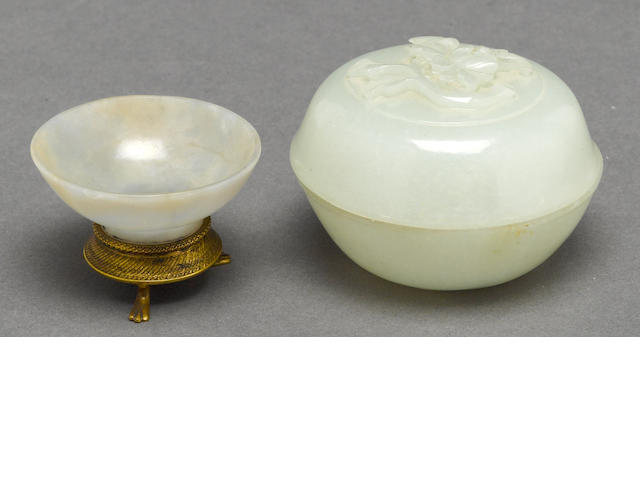A jade circular covere box, together with a small jade cup mounted with metal base