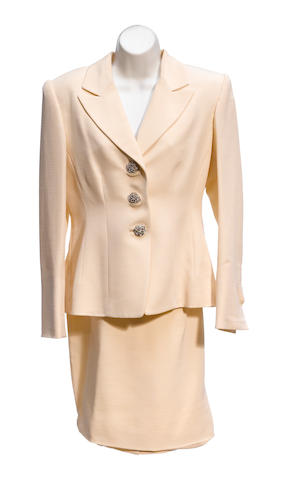 A Badgley Mischka cream and rhinestone and lace beaded jacket and skirt