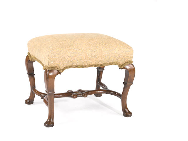A George II walnut stool<BR />second quarter 18th century