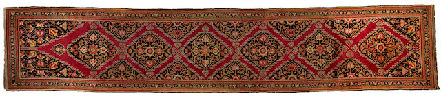 A Karabagh runner Caucasus size approximately 3ft. 7in. x 18ft. 2in.