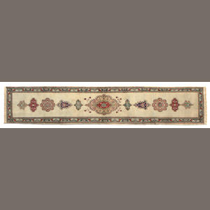 A Tabriz runner size approximately 2ft. 6in. x 12ft. 11in.