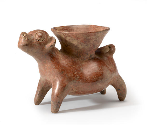 A large Colima dog with Vessel