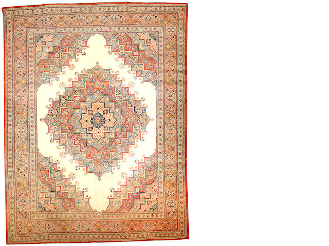 A Hadji Jalili Tabriz carpet  Northwest Persia size approximately 9ft. 5in. x 12ft. 6in.