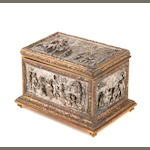 A silver and gilt metal table box with cast ornament