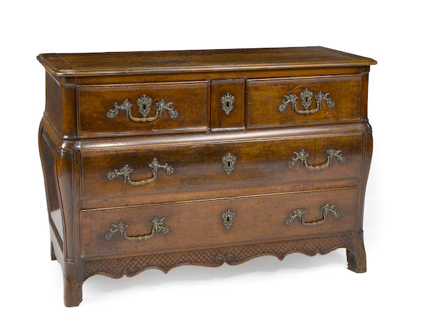 A Regence walnut commode en tombeau  second quarter 18th century (feet reduced in height)