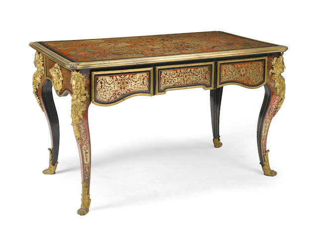 A Regence style gilt bronze and boulle mounted ebonized bureau plat<BR />third quarter 19th century