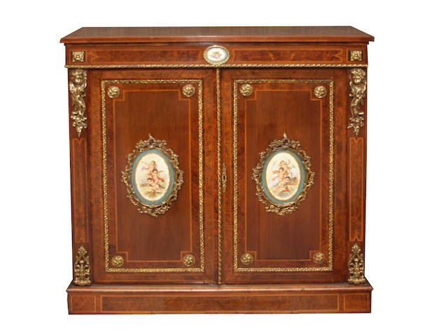 A French gilt bronze and porcelain mounted mahogany side cupboard