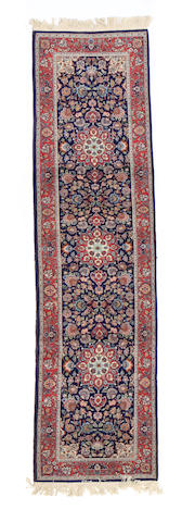 A Tabriz design runner size approximately 2ft. 6in. x 10ft.