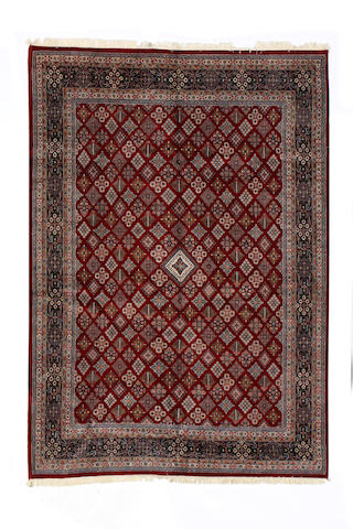 A Pakistani carpet size approximately 12ft. x 16ft.